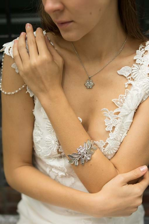 Our leafy and crystal bracelet and matching earrings are the perfect match for our tiara!